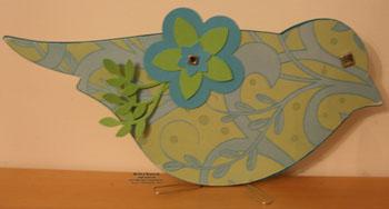 On board bird book green leaves watermark